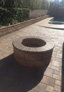 Circular Fire Pit Constructed with Angelus Courtyard Sand Stone Mocha Pavers
