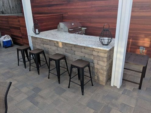 Rustic wall BBQ constructed with Angelus courtyard and stone mocha pavers